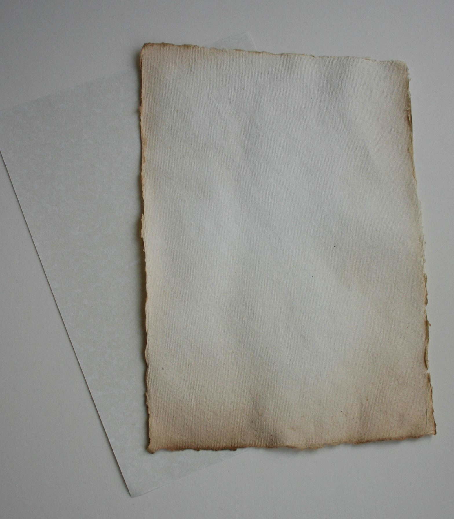 Parchment paper and aged, hand made paper
